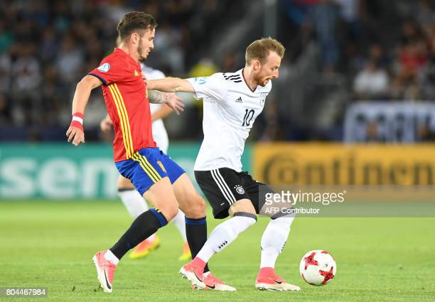 Germany's midfielder Maximilian Arnold vies for the ball with Spain's midfielder Saul Niguez during the UEFA U21 European Championship football final...