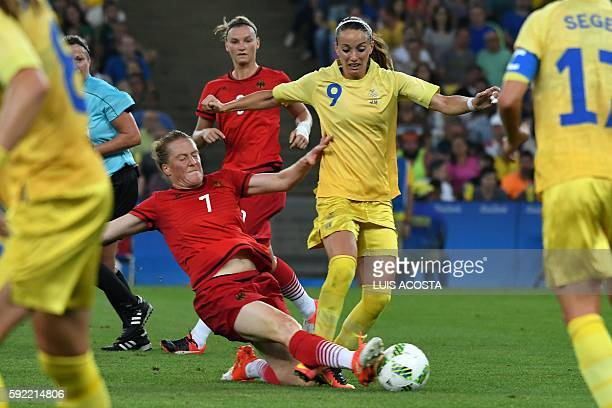 Germany's midfielder Melanie Behringer and Sweden's midfielder Kosovare Asllani vie for the ball during the Rio 2016 Olympic Games women's football...