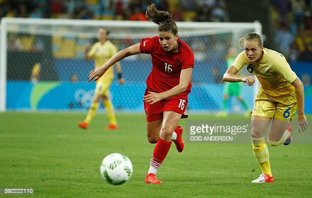 Germany's midfielder Melanie Leupolz and Sweden's defender Magdalena Eriksson vie for the ball during the Rio 2016 Olympic Games women's football...