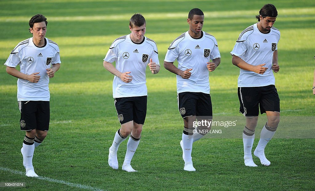 Germany's midfielder Mesut Oezil, midfielder Toni Kroos, defender Dennis Aogo and midfielder Sami Khedira warm up for a training match Germany vs Sued Tyrol FC at the team's training centre in Appiano, near the north Italian city of Bolzano May 24, 2010. The German football team is currently taking part in a 12-day training camp in Appiano to prepare for the upcoming FIFA Football World Cup in South Africa.