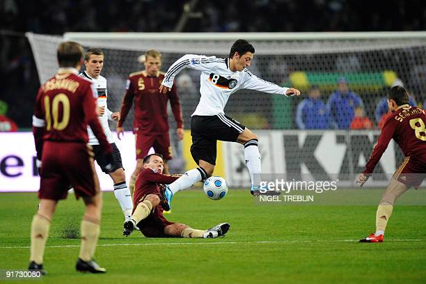 Germany's midfielder Mesut Oezil vies with Russia's midfielder Konstantin Zyryanov during their Russia vs Germany football World Cup 2010 qualifying...