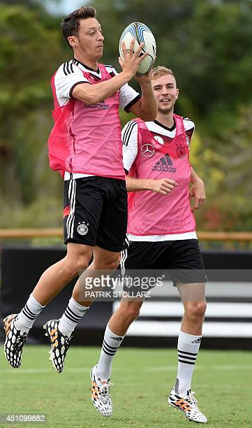 Germany's midfielder Mesut Ozil warms up with a rugby ball during a training session in Santo Andre on June 23 during the 2014 FIFA World Cup...