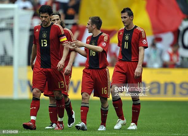 Germany's midfielder Michael Ballack Germany's midfielder Torsten Frings Germany's defender Philipp Lahm and Germany's striker Miroslav Klose walk...