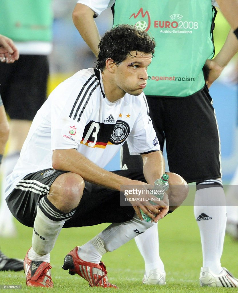 Germany's midfielder Michael Ballack looks on after the Euro 2008 championships final football match Germany vs. Spain on June 29, 2008 at Ernst-Happel stadium in Vienna, Austria. Spain won their first trophy in 44 years as they beat three-time champions Germany 1-0 in the Euro 2008 final. AFP PHOTO DDP / THOMAS LOHNES -- MOBILE SERVICES OUT --