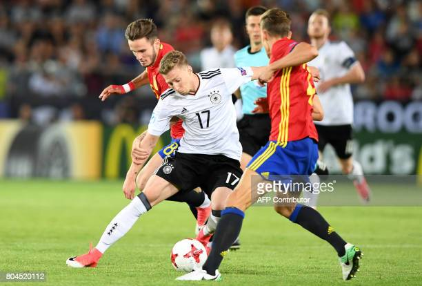 Germany's midfielder Mitchell Weiser and Spain's midfielder Saul Niguez vie for the ball during the UEFA U21 European Championship football final...