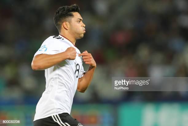 Germany's midfielder Nadiem Amiri celebrate scoring during the UEFA U21 European Championship Group C football match Germany v Denmark in Krakow...
