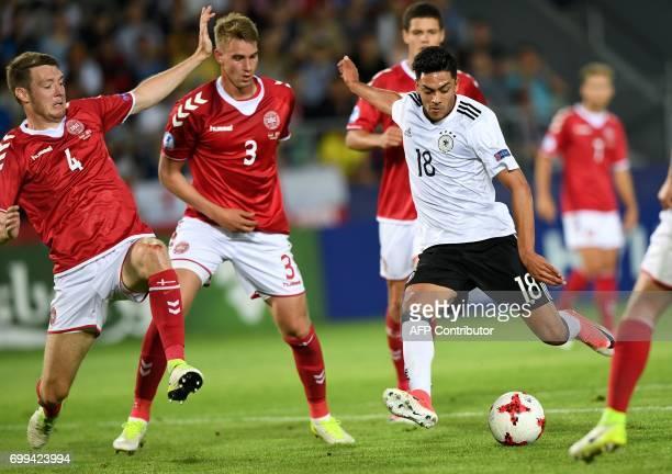 Germany's midfielder Nadiem Amiri scores during the UEFA U21 European Championship Group C football match Germany v Denmark in Krakow Poland on June...