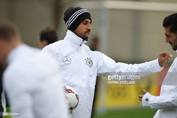 Germany's midfielder Sami Khedira and Emre Can take part in a training session in Dortmund western Germany on March 21 on the eve of the friendly...