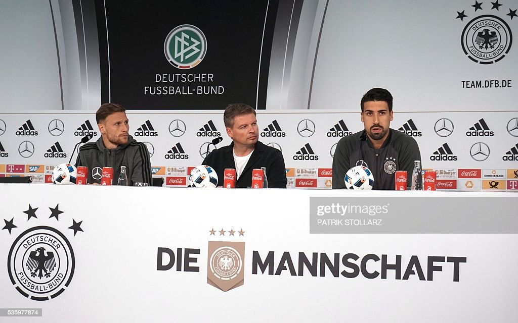 Germany's midfielder Sami Khedira (R) and Germany's defender Benedikt Hoewedes (L) give a press conference on the sideline of the team's preparation for the upcoming Euro 2016 European football championships, on May 31, 2016 in Ascona. / AFP / PATRIK