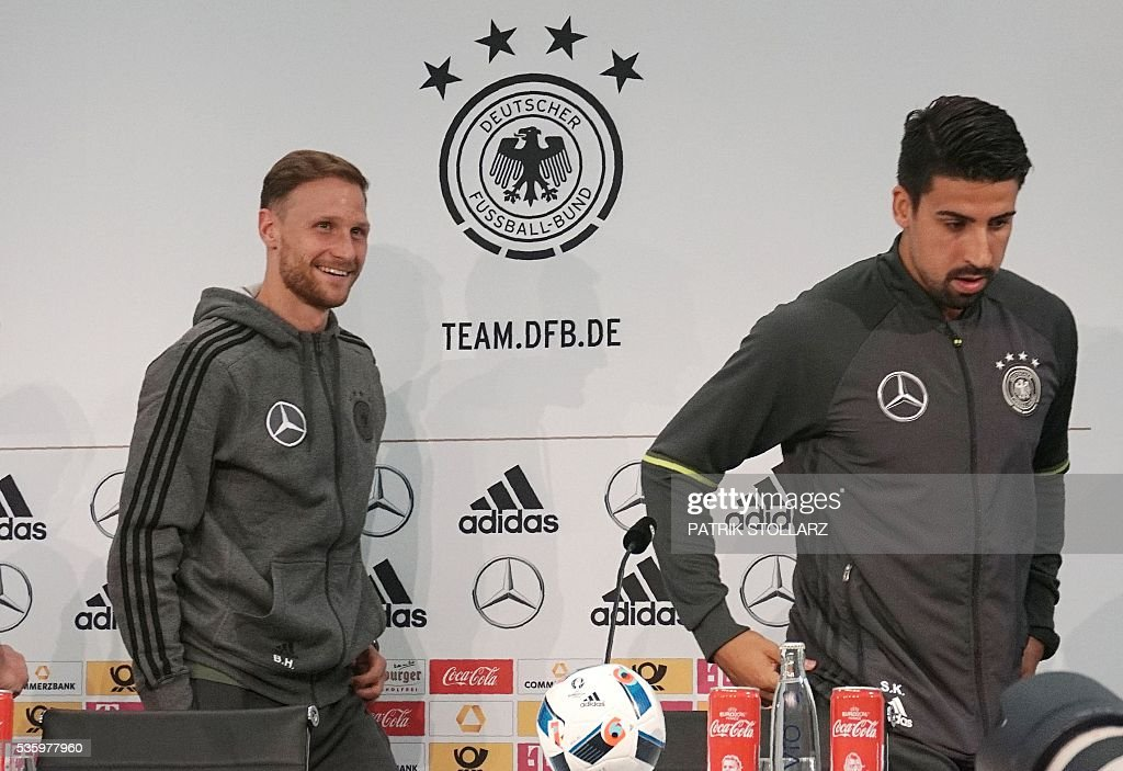 Germany's midfielder Sami Khedira (R) and Germany's defender Benedikt Hoewedes give a press conference on the sideline of the team's preparation for the upcoming Euro 2016 European football championships, on May 31, 2016 in Ascona. / AFP / PATRIK