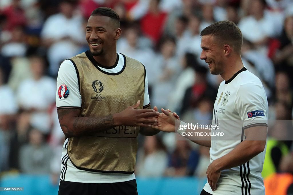 Germany's midfielder Sami Khedira and Germany's forward Lukas Podolski (R) celebrate at the end of the Euro 2016 round of 16 football match between Germany and Slovakia at the Pierre-Mauroy stadium in Villeneuve-d'Ascq near Lille on June 26, 2016. / AFP / KENZO