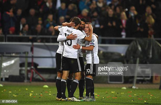 Germany's midfielder Sami Khedira and his taemmates celebrate after scorin 20 during the WC 2018 football qualification match between Germany and...