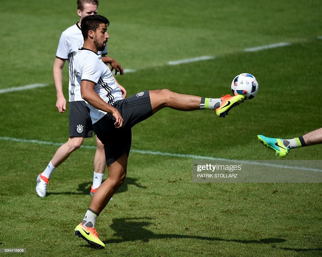 Germany's midfielder Sami Khedira controls a ball during a training session as part of the team's preparation for the upcoming Euro 2016 European football championships, on May 26, 2016 in Ascona. / AFP / PATRIK
