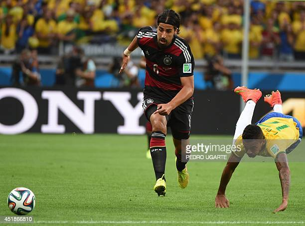 Germany's midfielder Sami Khedira controls the ball as Brazil's midfielder Luiz Gustavo dives during the semifinal football match between Brazil and...