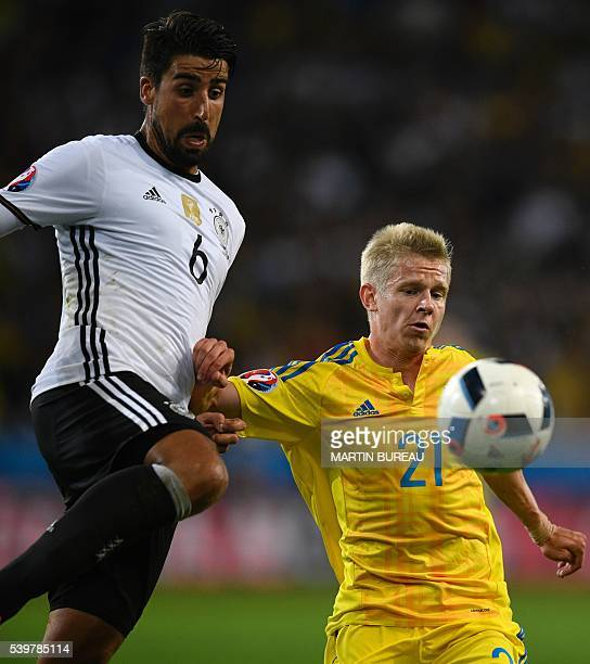 Germany's midfielder Sami Khedira vies for the ball with Ukraine's midfielder Olexandr Zinchenko during the Euro 2016 group C football match between...