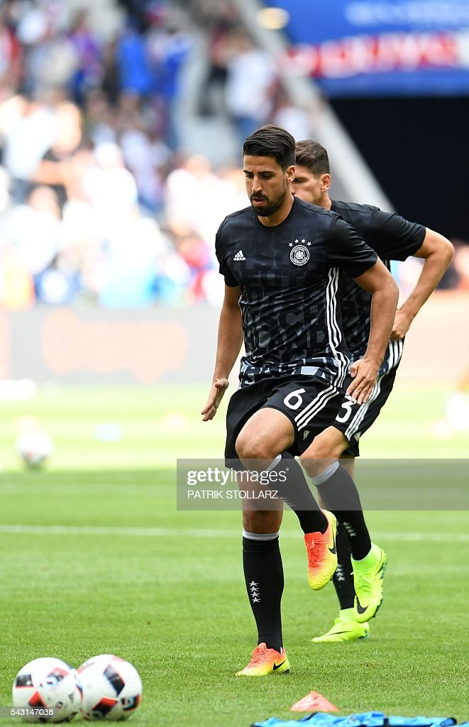 Germany's midfielder Sami Khedira warms up ahead of the Euro 2016 round of 16 football match between Germany and Slovakia at the Pierre-Mauroy stadium in Villeneuve-d'Ascq near Lille on June 26, 2016. / AFP / PATRIK