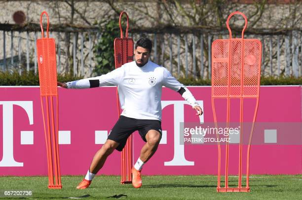 Germany's midfielder Sami Khedira warms up during a training session on march 24 2017 in KamenKaiserau western Germany ahead of the World Cup...