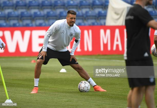 Germany's midfielder Sandro Wagner warms up during a training session in Brondby Denmark on June 5 2017 on the eve of a friendly football match...