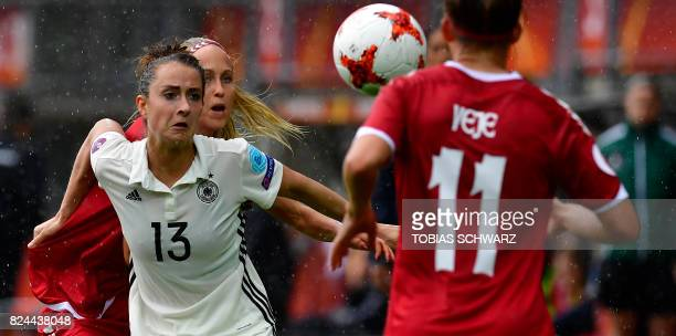 Germany's midfielder Sara Daebritz holds off Denmark's defender Line Roddik Hansen during the quarter final match of the UEFA Women's Euro 2017...