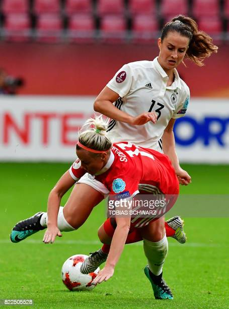 Germany's midfielder Sara Daebritz vies with Russia's midfielder Ekaterina Sochneva during the UEFA Women's Euro 2017 football match between Russia...