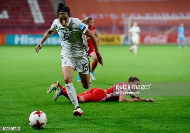 Germany's midfielder Sara DoorsounKhajeh vies with Russia's defender Natalya Solodkaya during the UEFA Women's Euro 2017 football match between...