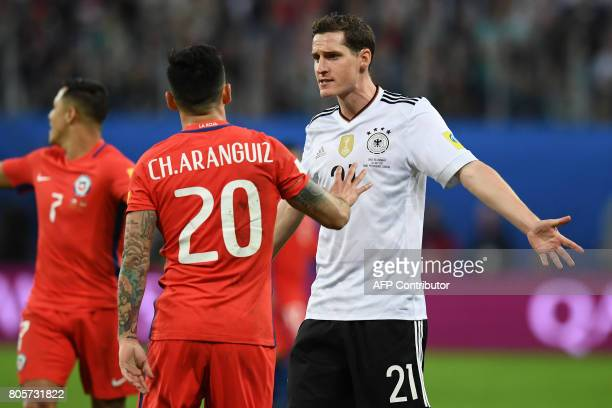 Germany's midfielder Sebastian Rudy and Chile's midfielder Charles Aranguiz argue during the 2017 Confederations Cup final football match between...
