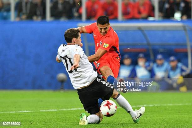 Germany's midfielder Sebastian Rudy vies with Chile's forward Alexis Sanchez during the 2017 Confederations Cup final football match between Chile...