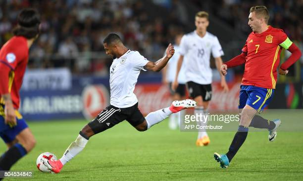 Germany's midfielder Serge Gnabry vies with Spain's midfielder Gerard Deulofeu during the UEFA U21 European Championship football final match Germany...