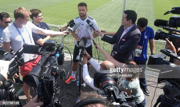 Germany's midfielder Shkodran Mustafi speaks to the press ahead of a training session in Sochi on June 27 2017 during the 2017 FIFA Confederations...