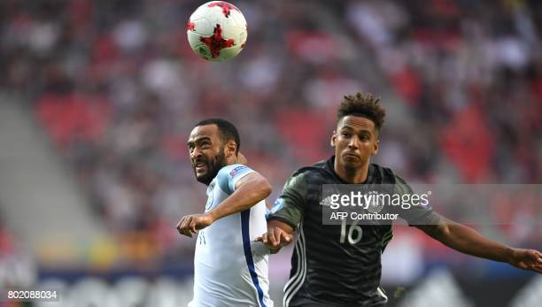 Germany's midfielder Thilo Kehrer and England's midfielder Nathan Redmond vie for the ball during the UEFA U21 European Championship football semi...