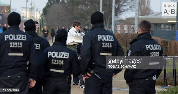 Germany's midfielder Thomas Mueller arrives for a training session as police guard in Berlin on March 24 2016 Germany face England in a preEURO 2016...