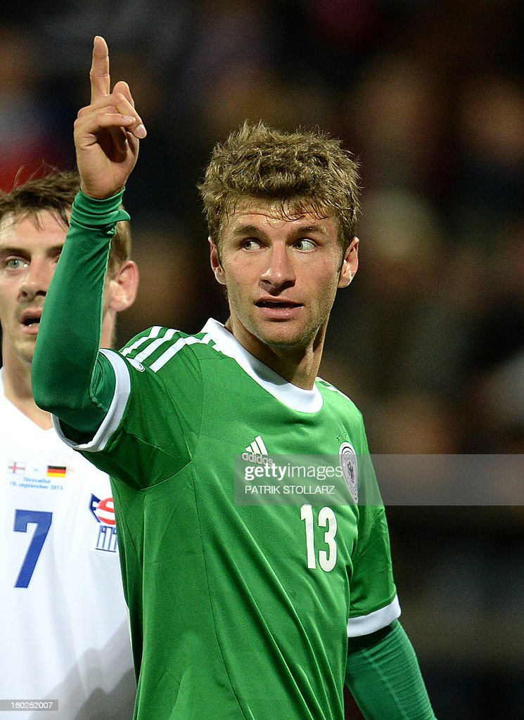 Germany's midfielder Thomas Mueller celebrates scoring during the FIFA World Cup 2014 qualifying football match Faroe Island vs Germany in Torshavn on September 10, 2013.