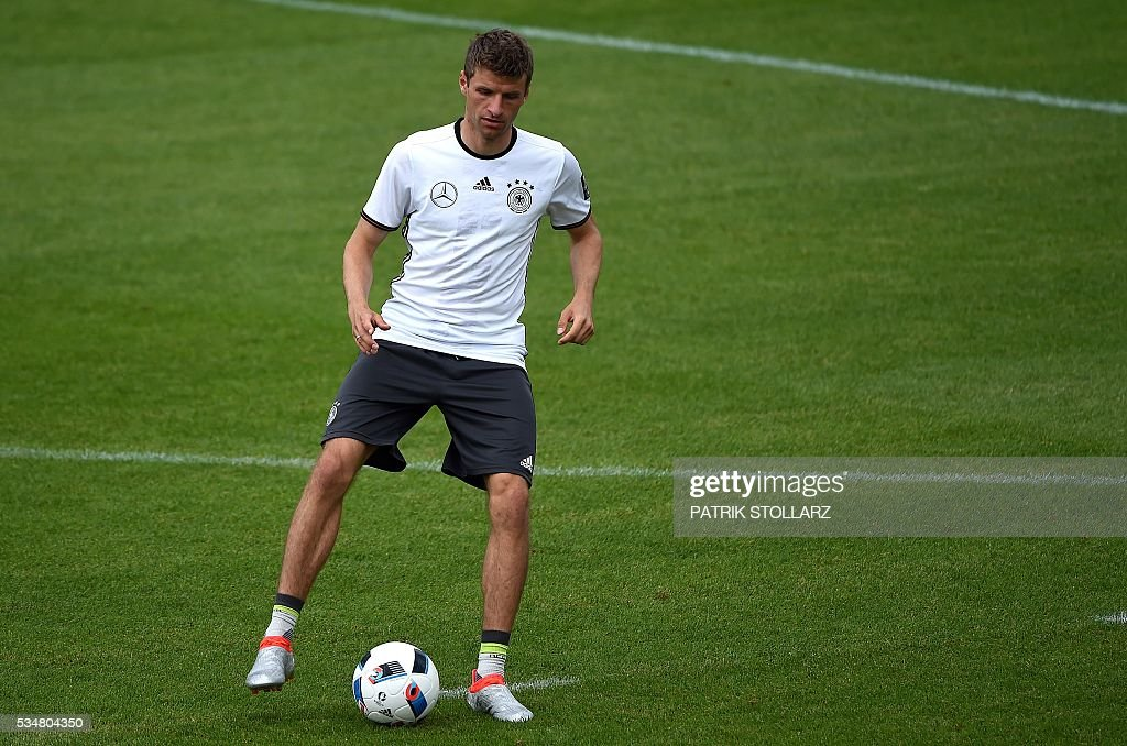 Germany's midfielder Thomas Mueller dribbles with a ball during a training session as part of the team's preparation for the upcoming Euro 2016 European football championships, on May 28, 2016 in Ascona. / AFP / PATRIK