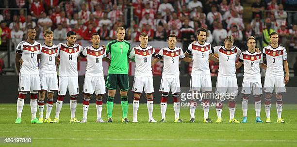 Germany's midfielder Thomas Mueller Germany's midfielder Emre Can Germany's forward Karim Bellarabi Germany's goalkeeper Manuel Neuer Germany's...