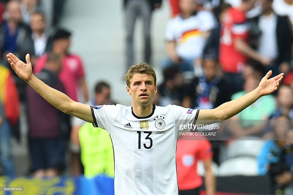 Germany's midfielder Thomas Mueller gestures during Euro 2016 round of 16 football match between Germany and Slovakia at the Pierre-Mauroy stadium in Villeneuve-d'Ascq, near Lille, on June 26, 2016. / AFP / PATRIK