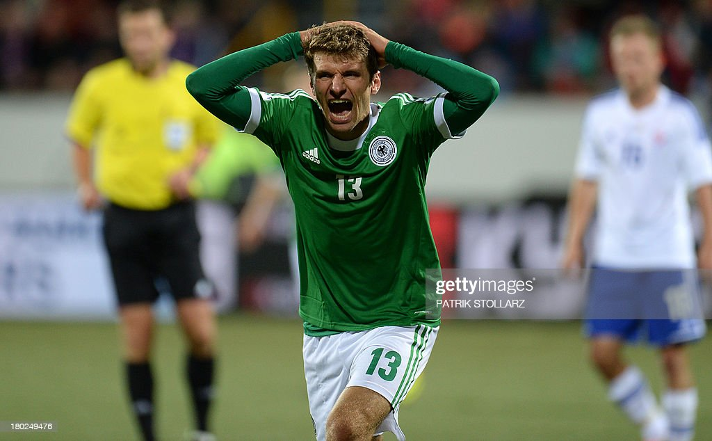 Germany's midfielder Thomas Mueller reacts during the FIFA World Cup 2014 qualifying football match Faroe Island vs Germany in Torshavn on September 10, 2013.