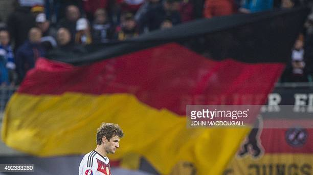 Germany's midfielder Thomas Mueller walks off the pitch after the Euro 2016 Group D qualifying football match between Germany and Georgia in Leipzig...