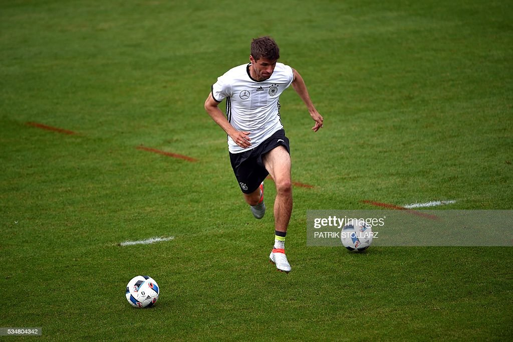 Germany's midfielder Thomas Mueller warms up during a training session as part of the team's preparation for the upcoming Euro 2016 European football championships, on May 28, 2016 in Ascona. / AFP / PATRIK