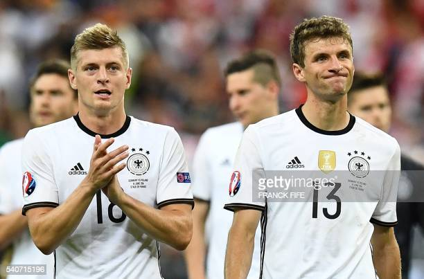 TOPSHOT Germany's midfielder Toni Kroos and Germany's midfielder Thomas Mueller acknowledge the crowd following their 00 draw in the Euro 2016 group...
