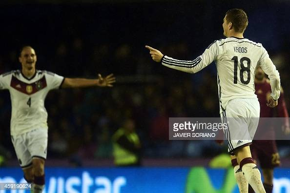 Germany's midfielder Toni Kroos celebrates after scoring during a friendly football match Spain vs Germany at the Balaidos stadium in Vigo on...