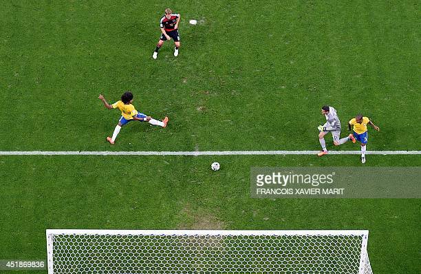 Germany's midfielder Toni Kroos scores during the semifinal football match between Brazil and Germany at The Mineirao Stadium in Belo Horizonte...
