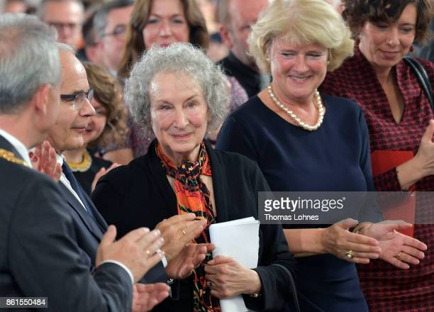 Germany's minister of culture Monika Gruetters and guest applaud Margaret Atwood during the 'Peace Prize of the German Book Trade' ceremony of German...