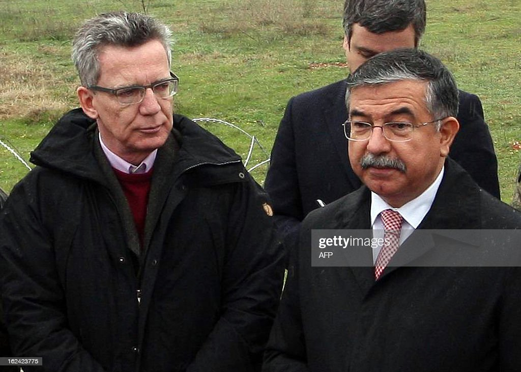 Germany's Minister of Defense Thomas de Maiziere (L) and Ismet Yilmaz of Turkey speak to the press during a visit to NATO German patriot troops at a Turkish military base in Kahramanmaras on February 23, 2013.