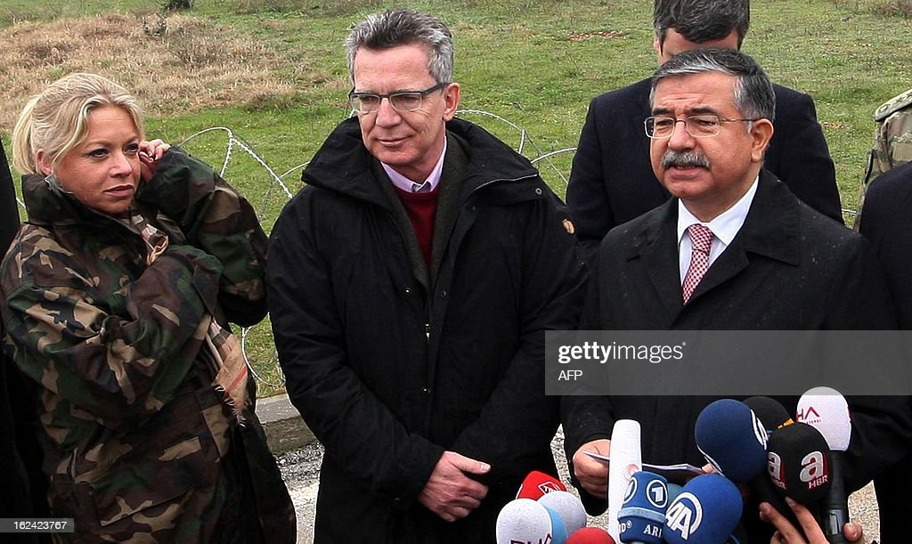 Germany's Minister of Defense Thomas de Maiziere (), flanked by his counterparts Jeanine Hennis-Plasschaert of the Netherlands (L) and Ismet Yilmaz of Turkey (R), speak during a visit to NATO German patriot troops at a Turkish military base in Kahramanmaras on February 23, 2013.