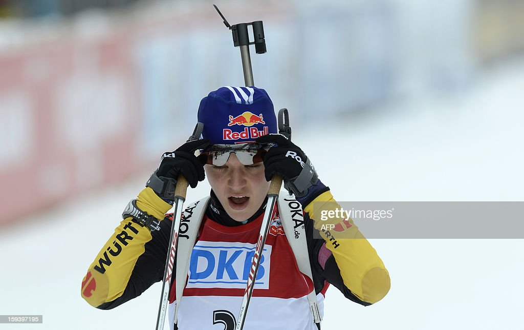 Germany's Miriam Goessner reacts as she arrives at the finish after the 12,5 km women Biathlon World Cup mass start competition on January 13, 2013, in Ruhpolding, southern Germany.Norway's Tora Berger won the competition, Belarus Darya Domracheva placed second and Russia's Olga Zaitseva placed third. AFP PHOTO/CHRISTOF STACHE