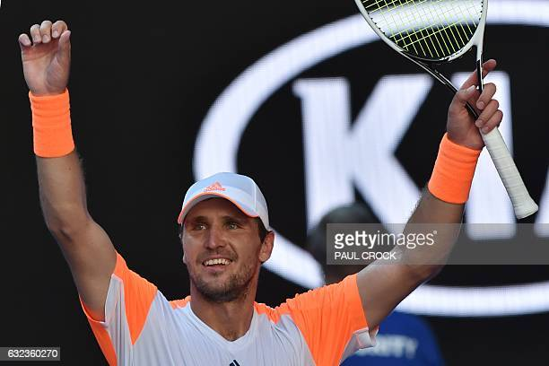 Germany's Mischa Zverev celebrates his victory against Britain's Andy Murray during their men's singles fourth round match on day seven of the...