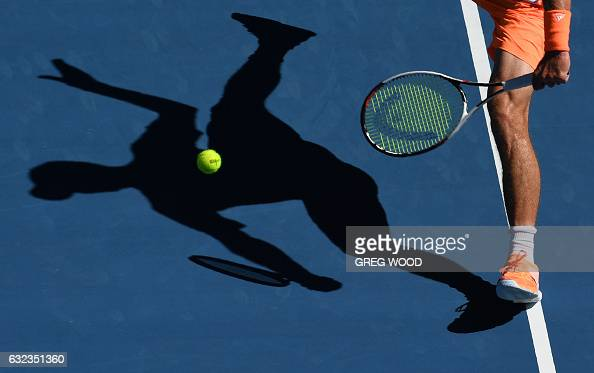 TOPSHOT Germany's Mischa Zverev hits a return against Britain's Andy Murray during their men's singles fourth round match on day seven of the...