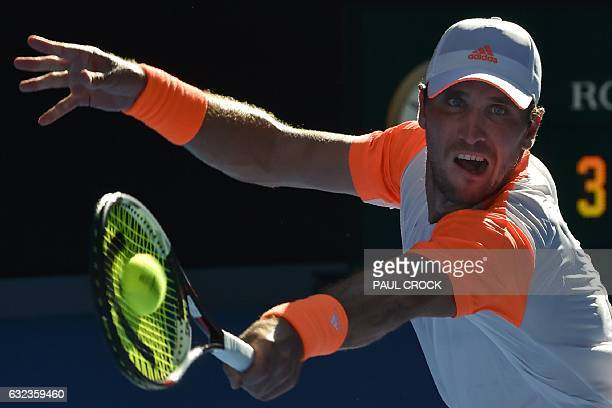 Germany's Mischa Zverev hits a return against Britain's Andy Murray during their men's singles fourth round match on day seven of the Australian Open...