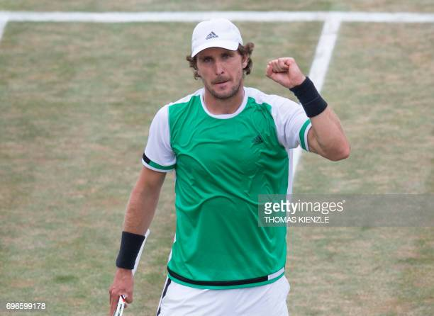 Germany's Mischa Zverev reacts after he defeated his fellow countryman Tommy Haas in their quarterfinal match at the ATP Cup tennis tournament in...