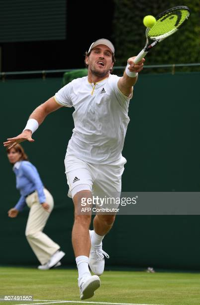 Germany's Mischa Zverev returns against Australia's Bernard Tomic during their men's singles first round match on the second day of the 2017...